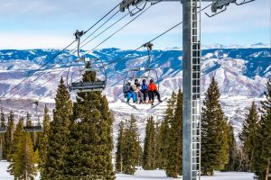 Family of 4 on the ski lift at Snowmass Village