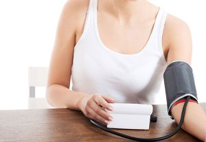 A woman checking her blood pressure